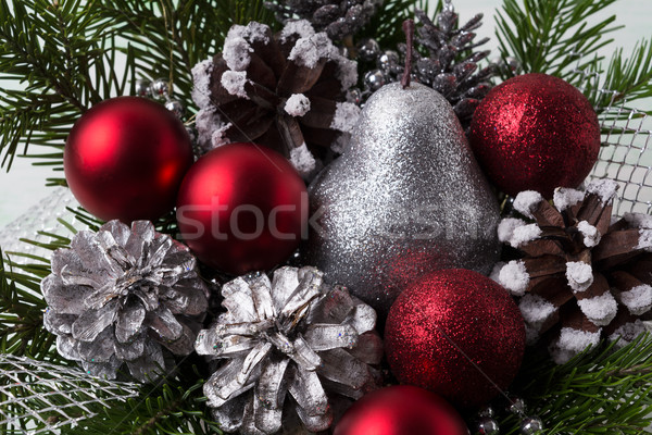 Christmas red ornaments, silver pine cones and glitter pear Stock photo © TasiPas