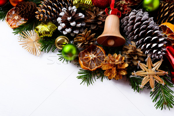 Christmas greeting background with handmade wooden jingle bell a Stock photo © TasiPas