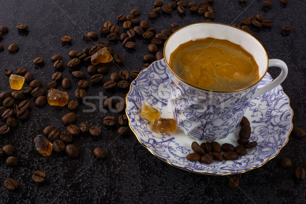 Coffee grains and china cup of coffee Stock photo © TasiPas