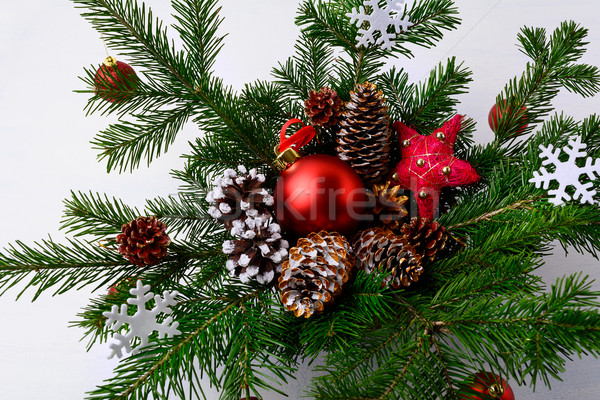 Christmas table centerpiece with golden decorated pine cones and Stock photo © TasiPas