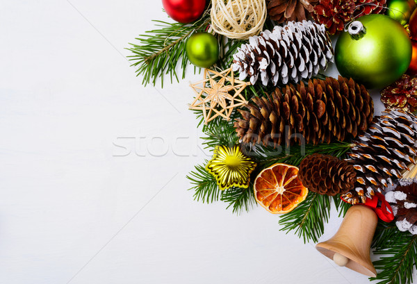 Christmas decoration with wooden jingle bell and straw ornaments Stock photo © TasiPas