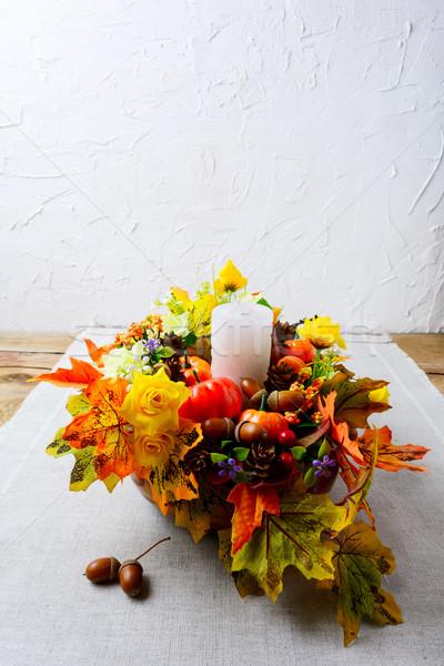 Thanksgiving decoration with silk fall leaves on linen napkin, v Stock photo © TasiPas