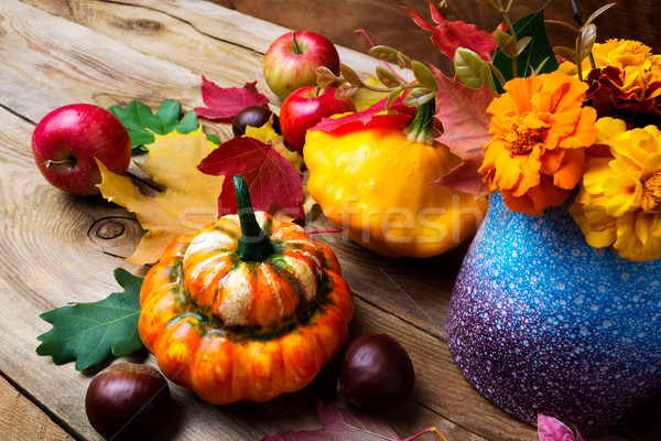 Holiday fall arrangement with pumpkin, chestnut and apples Stock photo © TasiPas