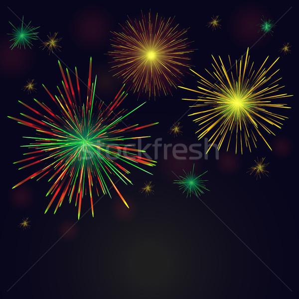 Vector golden, green, red fireworks set over night sky Stock photo © TasiPas