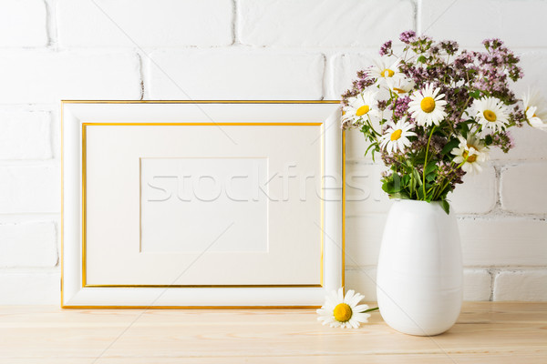 Gold decorated landscape frame mockup with blooming wildflower b Stock photo © TasiPas