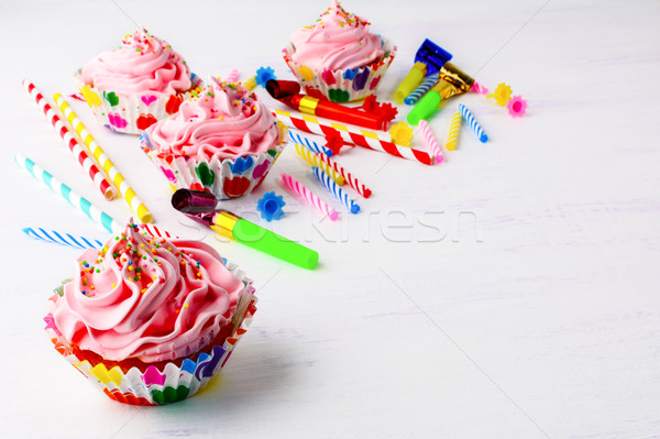 Birthday party background with decorated pink cupcakes  and cand Stock photo © TasiPas