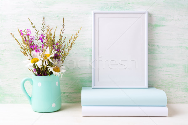 White frame mockup with chamomile and purple flowers in mint gre Stock photo © TasiPas
