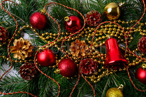 Christmas background with golden Christmas beads and red ornamen Stock photo © TasiPas