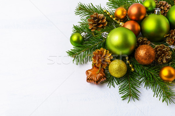 Green Christmas ornaments, fir branches, golden pine cones and b Stock photo © TasiPas