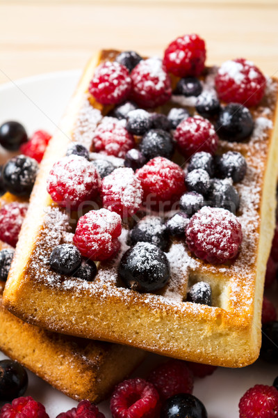 Belgian waffles with fresh berries powdered by caster sugar Stock photo © TasiPas