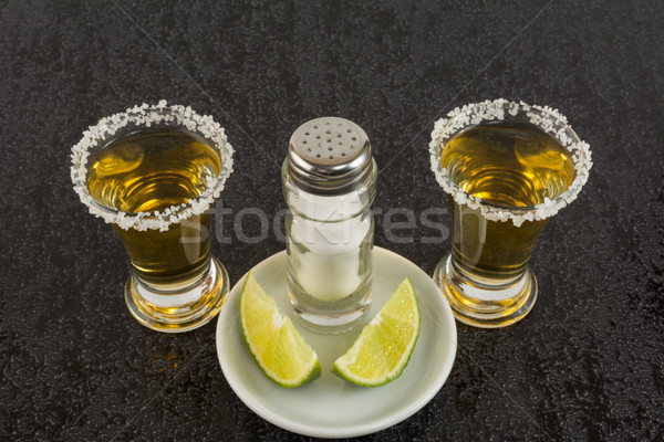 Two gold tequila shots Stock photo © TasiPas