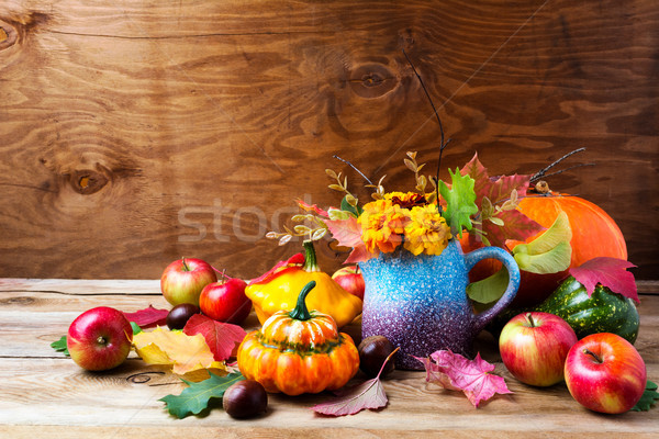 Rustic Thanksgiving arrangement with pumpkins and tagetes flower Stock photo © TasiPas