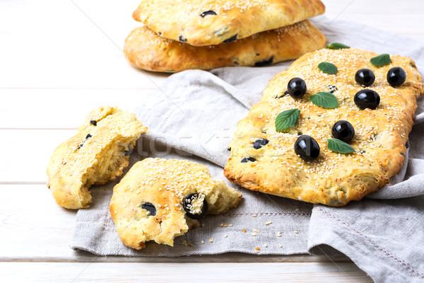 Fresh Italian bread with olive, garlic and herbs  Stock photo © TasiPas