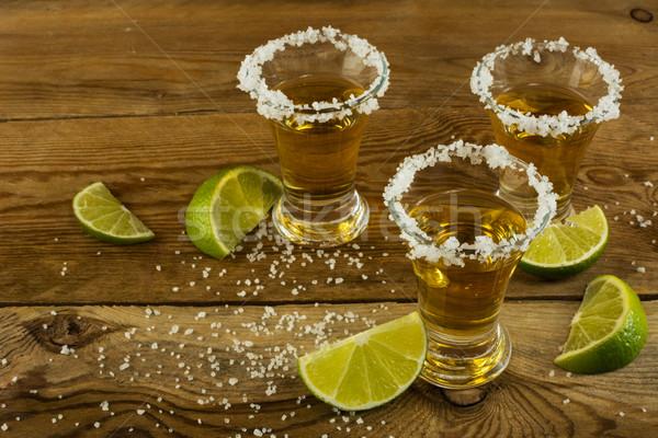 Tequila kalk zout shot alcohol drinken Stockfoto © TasiPas