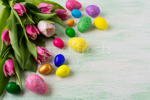 Easter background with vibrant painted eggs Stock photo © TasiPas