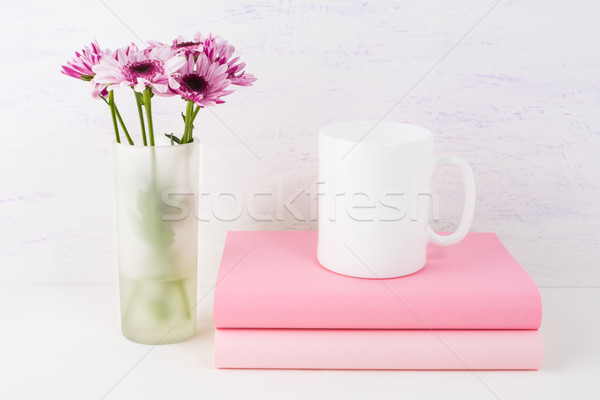 Coffee mug mockup with lilac daisy Stock photo © TasiPas