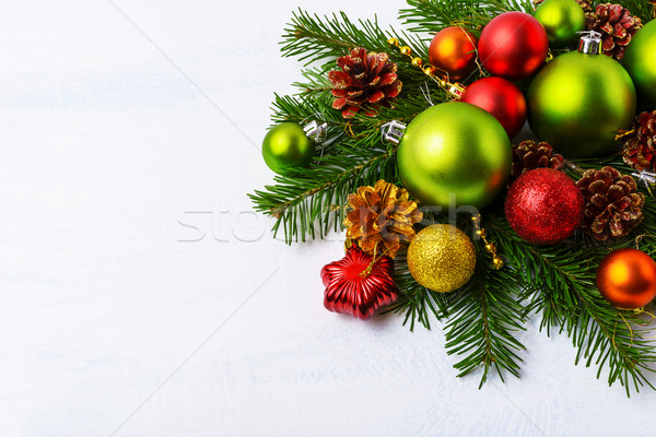 Green Christmas ornaments, fir branches, red star and baubles Stock photo © TasiPas
