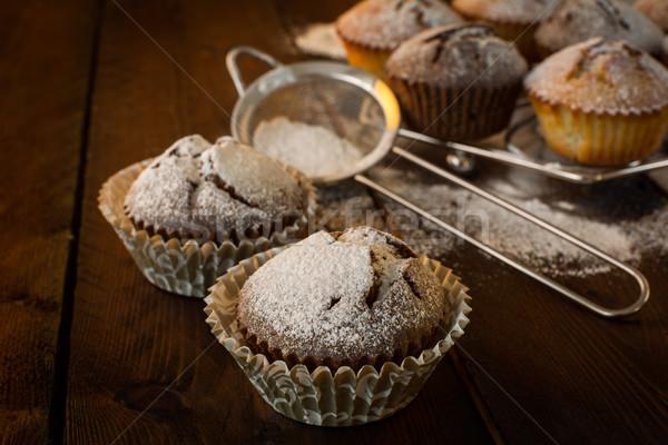 Muffins and baking sieve Stock photo © TasiPas