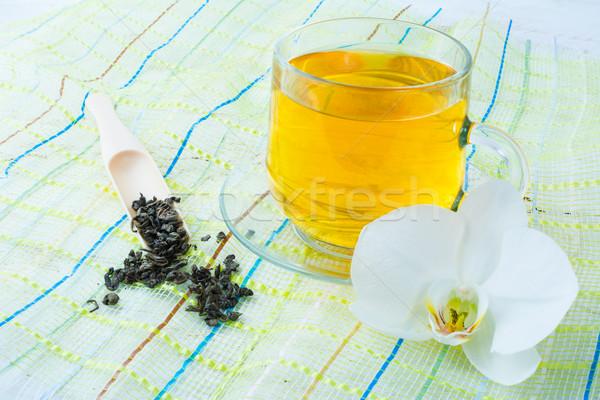 Copo chá verde verde guardanapo branco orquídea Foto stock © TasiPas