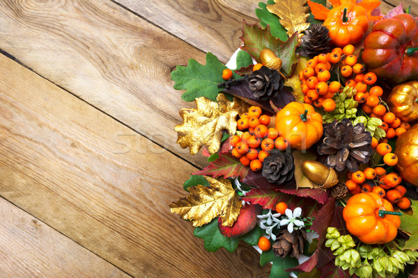 Fall arrangement with frame of pumpkins, berries and cones Stock photo © TasiPas