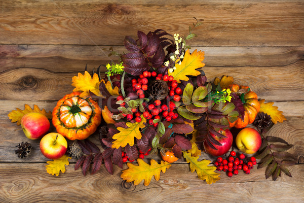 Thanksgiving centerpiece with berries, rowan and oak leaves  Stock photo © TasiPas
