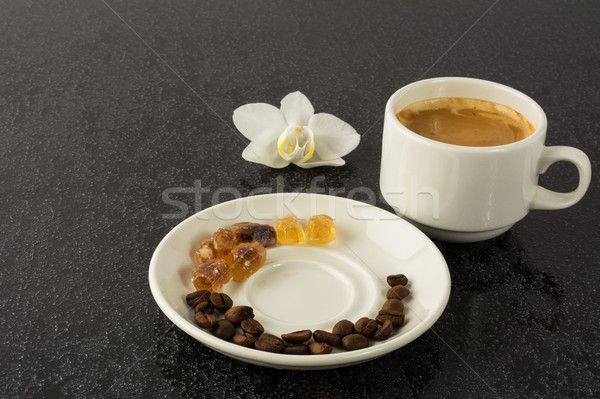 Coffee grains, cup of coffee and orchid Stock photo © TasiPas