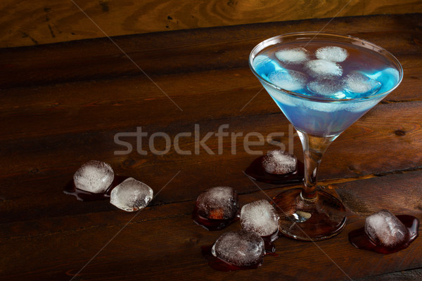 Iced blue cosmopolitan cocktail on wooden background Stock photo © TasiPas