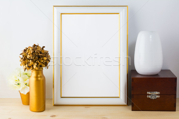 Frame mockup with vases, wooden box and golden flower pot Stock photo © TasiPas