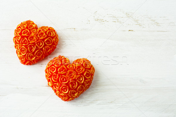 Two hearts of roses on a white wooden background Stock photo © TasiPas