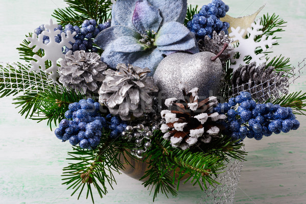 Christmas background with blue silk poinsettias and glitter berr Stock photo © TasiPas