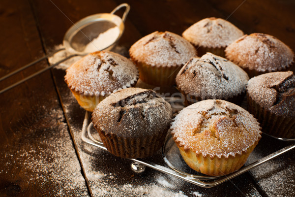 Muffins on metal stand Stock photo © TasiPas