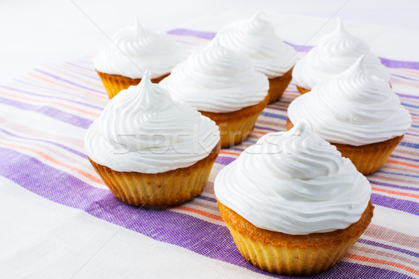 Sweet cupcakes with white whipped cream  Stock photo © TasiPas