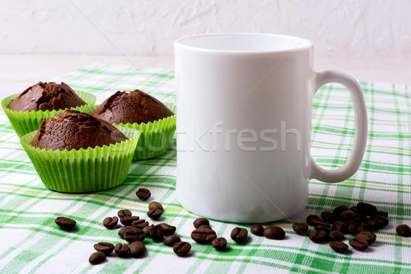 Fehér bögre vázlat csokoládé muffinok zöld Stock fotó © TasiPas