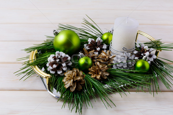Christmas centerpiece with silver, snowy and bleached pine cones Stock photo © TasiPas