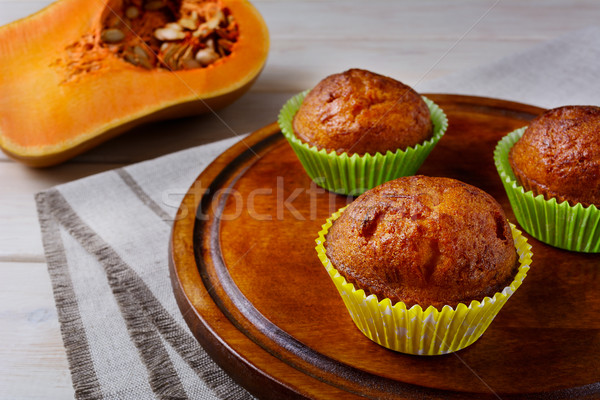Homemade pumpkin muffins on the cutting board and butternut squa Stock photo © TasiPas