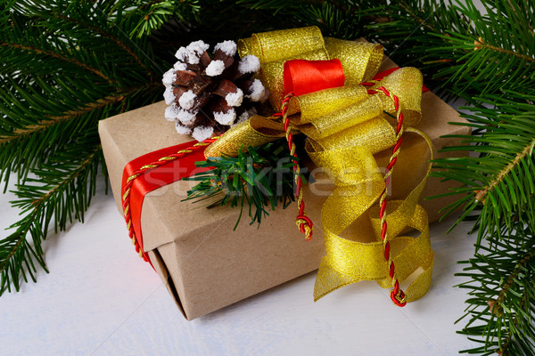 Christmas background with kraft paper wrapping Christmas present Stock photo © TasiPas