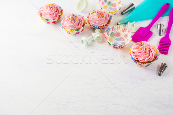 Pink cupcakes  and cookware invitation background Stock photo © TasiPas