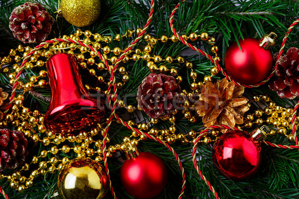 Christmas background with golden pinecone and red ornaments Stock photo © TasiPas