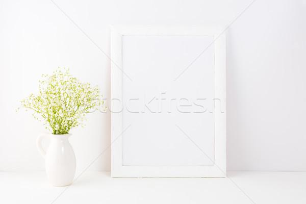 White frame mockup with Rue Anemone flowers Stock photo © TasiPas