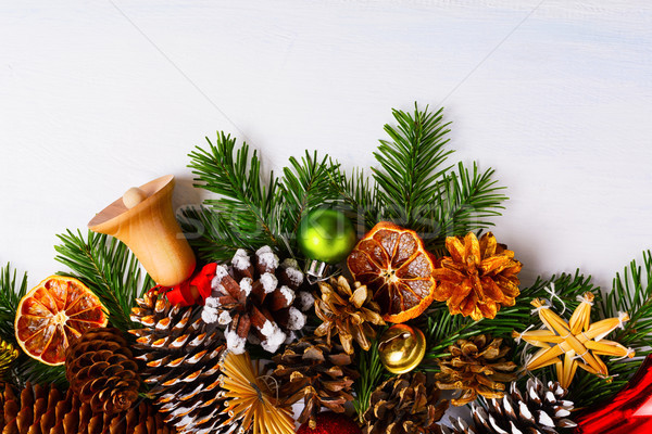 Christmas background with wooden and golden jingle bells, copy s Stock photo © TasiPas