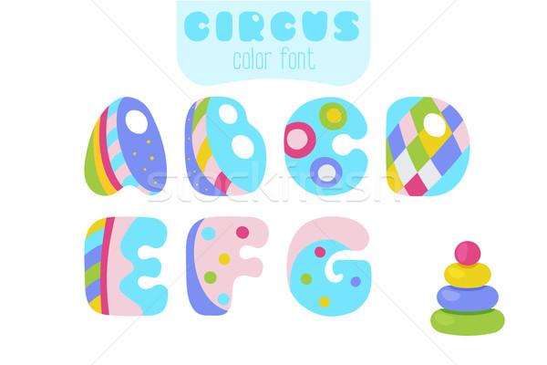 Cartoon style letters A, B, C, D, E, F, G and pyramid toy Stock photo © TasiPas