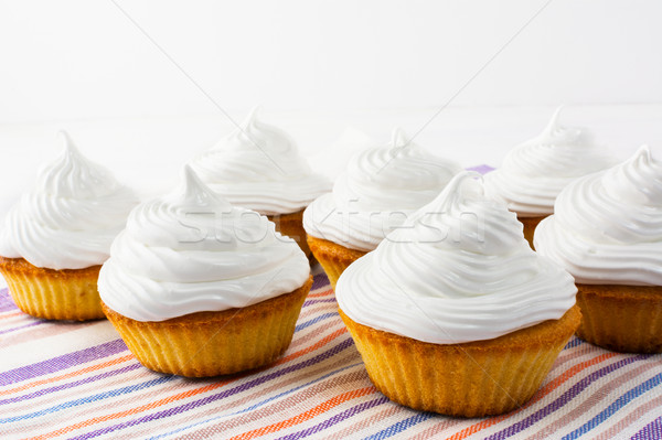 White cupcakes on the linen napkin Stock photo © TasiPas