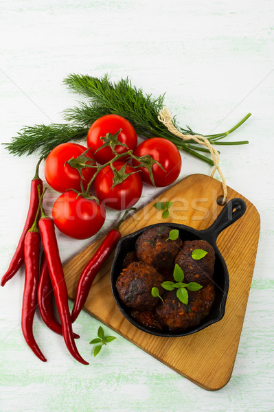 Grilled meatballs with chili pepper  served in cast iron skillet Stock photo © TasiPas