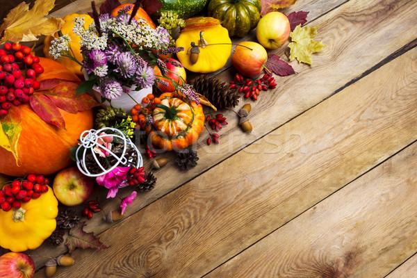 Thanksgiving arrangement with clover, apples, pumpkins, copy spa Stock photo © TasiPas