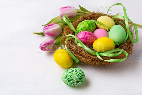 Pasen jacht symbool nest geschilderd eieren Stockfoto © TasiPas