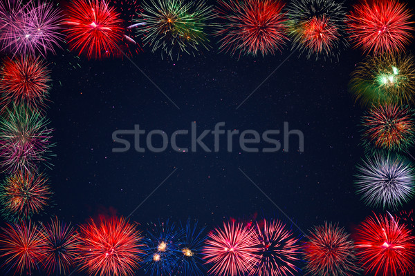 Amazing celebration sparkling fireworks over starry sky frame Stock photo © TasiPas