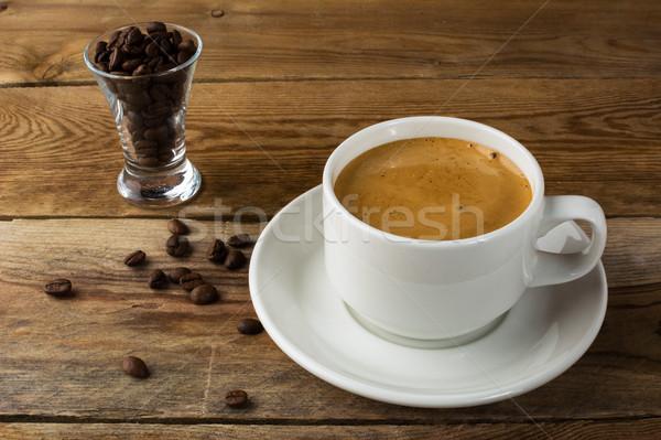 Xícara de café grãos de café rústico copo café forte Foto stock © TasiPas