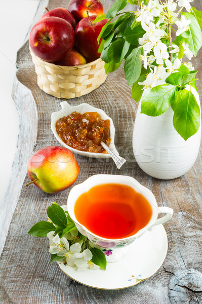 Cup of tea and apple jam on rustic wooden table  Stock photo © TasiPas