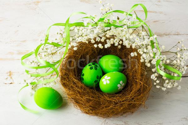 Groene paaseieren nest satijn lint klein Stockfoto © TasiPas