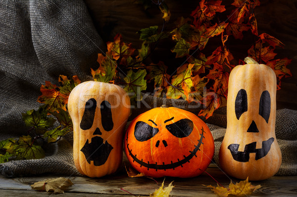 Halloween pumpkin heads on dark rustic background Stock photo © TasiPas